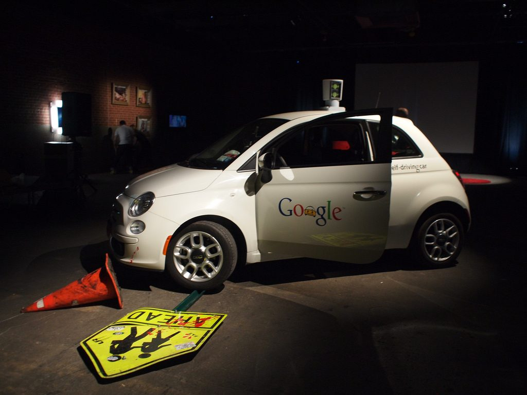 Self-driving cars can be seen roaming around the streets.